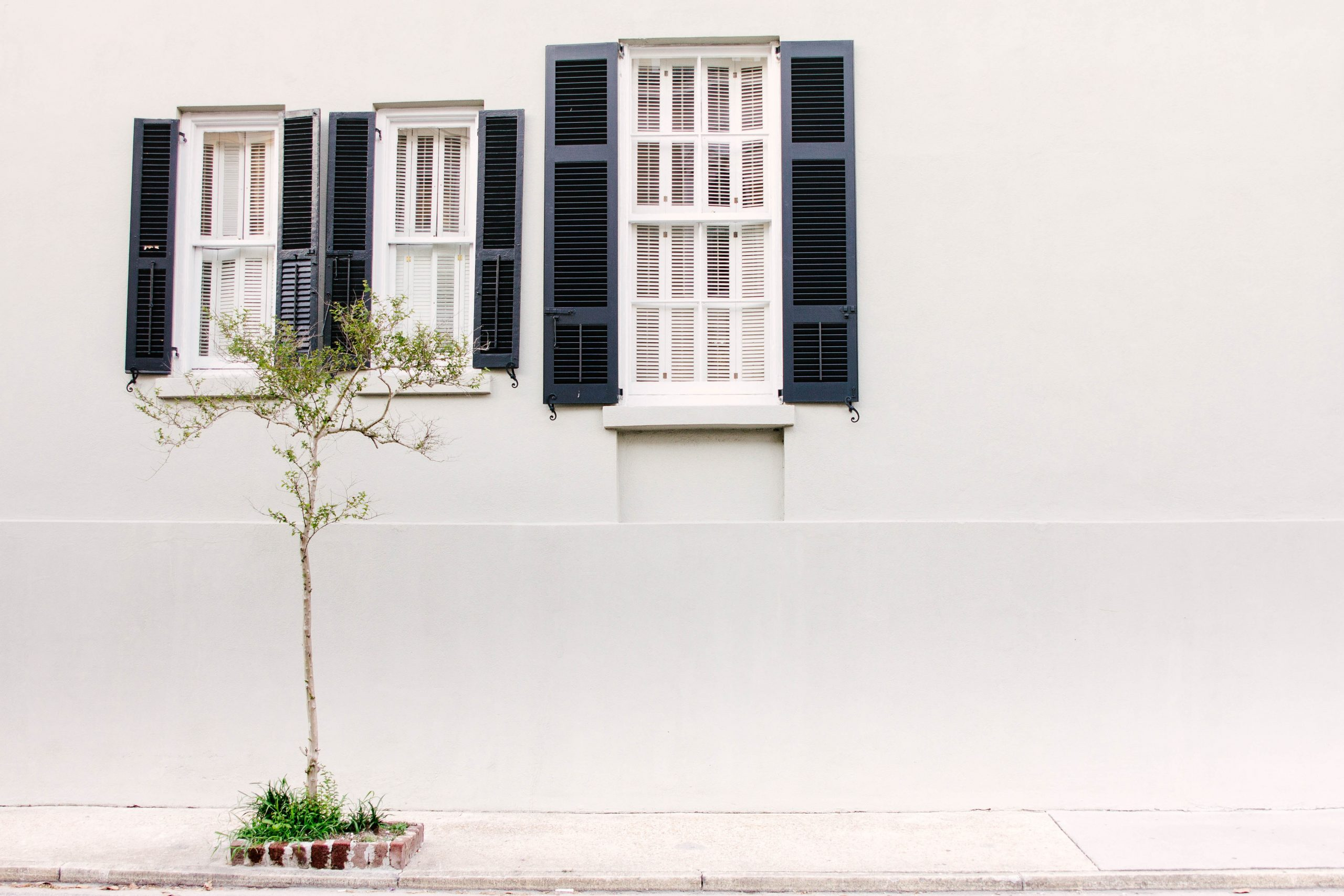 photo of three glass windows with white wooden frames
