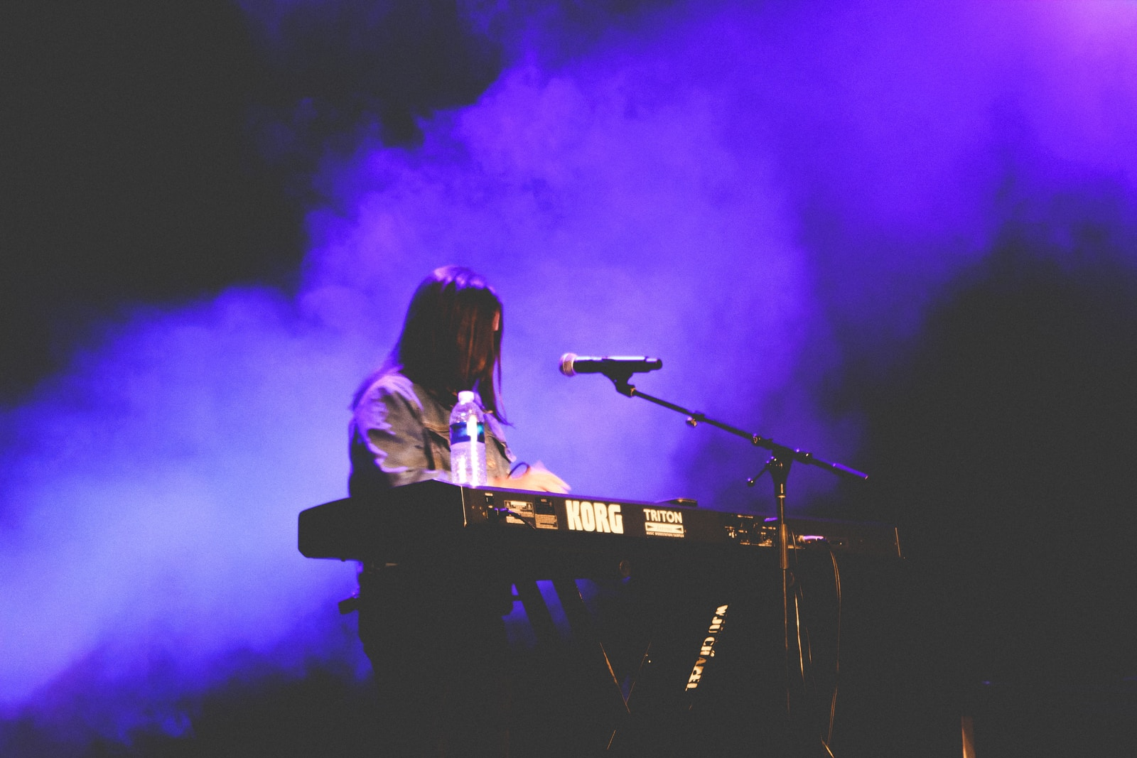 woman playing electronic keyboard
